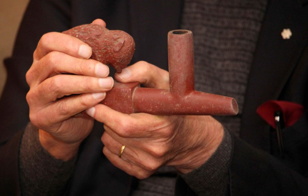 Douglas hands with pipe